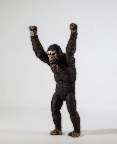 Caesar the ape with arms up in victory